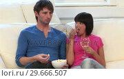 Купить «Young Couple Watching Television», видеоролик № 29666507, снято 1 марта 2008 г. (c) Wavebreak Media / Фотобанк Лори