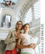 Купить «Woman and girl visiting museum», фото № 29666635, снято 18 августа 2018 г. (c) Яков Филимонов / Фотобанк Лори