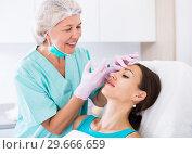 Купить «Young woman getting facial injection», фото № 29666659, снято 28 июля 2017 г. (c) Яков Филимонов / Фотобанк Лори