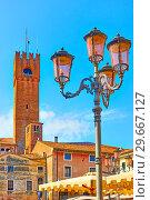 Купить «Old street lantern and Civic Tower of Treviso», фото № 29667127, снято 19 июня 2018 г. (c) Роман Сигаев / Фотобанк Лори