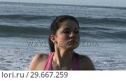 Купить «Woman Stretching on Beach», видеоролик № 29667259, снято 24 января 2019 г. (c) Wavebreak Media / Фотобанк Лори