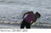 Купить «Woman Stretching on Beach», видеоролик № 29667263, снято 24 января 2019 г. (c) Wavebreak Media / Фотобанк Лори