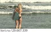 Купить «Woman with Surfboard», видеоролик № 29667339, снято 23 января 2019 г. (c) Wavebreak Media / Фотобанк Лори