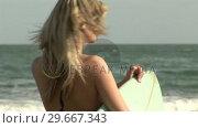 Купить «Woman with Surfboard», видеоролик № 29667343, снято 23 января 2019 г. (c) Wavebreak Media / Фотобанк Лори