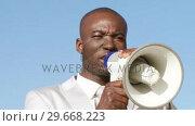 Successful businessman giving briefings via megaphone. Стоковое видео, агентство Wavebreak Media / Фотобанк Лори