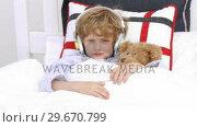 Купить «Young Boy on bed listening to Music», видеоролик № 29670799, снято 9 октября 2009 г. (c) Wavebreak Media / Фотобанк Лори