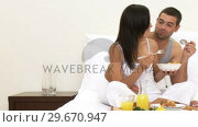 Panorama of wife and husband having nutritious breakfast in bed. Стоковое видео, агентство Wavebreak Media / Фотобанк Лори