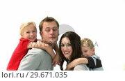 Купить «Happy parents giving children piggyback rides», видеоролик № 29671035, снято 18 октября 2009 г. (c) Wavebreak Media / Фотобанк Лори