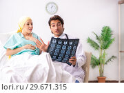 Купить «Young handsome doctor visiting female oncology patient», фото № 29671315, снято 3 октября 2018 г. (c) Elnur / Фотобанк Лори