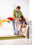 Купить «Husband helping leg injured wife in housework», фото № 29671679, снято 4 октября 2018 г. (c) Elnur / Фотобанк Лори