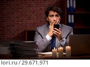 Купить «Businessman working late in office with candle light», фото № 29671971, снято 7 сентября 2018 г. (c) Elnur / Фотобанк Лори