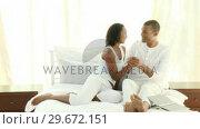 Купить «Woman showing her husband a positive pregnancy test», видеоролик № 29672151, снято 21 октября 2009 г. (c) Wavebreak Media / Фотобанк Лори