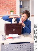 Купить «Young handsome employee working in the office», фото № 29672851, снято 12 сентября 2018 г. (c) Elnur / Фотобанк Лори