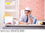 Купить «Construction supervisor working on blueprints», фото № 29672943, снято 13 сентября 2018 г. (c) Elnur / Фотобанк Лори