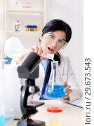 Купить «Female chemist working at the lab», фото № 29673543, снято 15 ноября 2018 г. (c) Elnur / Фотобанк Лори