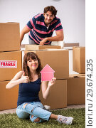 Купить «Young family moving to new house apartment», фото № 29674235, снято 21 сентября 2018 г. (c) Elnur / Фотобанк Лори