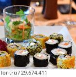 Купить «Set of sushi and salad in a glass on white plate», фото № 29674411, снято 6 апреля 2018 г. (c) Володина Ольга / Фотобанк Лори