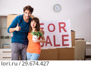 Купить «Young family offering house for sale and moving out», фото № 29674427, снято 21 сентября 2018 г. (c) Elnur / Фотобанк Лори