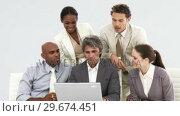 Купить «United business team working at a laptop», видеоролик № 29674451, снято 24 марта 2019 г. (c) Wavebreak Media / Фотобанк Лори