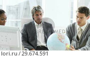 Купить «Ambitious business team looking at a terrestrial globe», видеоролик № 29674591, снято 21 февраля 2019 г. (c) Wavebreak Media / Фотобанк Лори