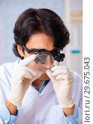 Купить «Young chemist working in the lab», фото № 29675043, снято 19 октября 2018 г. (c) Elnur / Фотобанк Лори