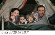 Купить «Family smilling at the camera in a tent», видеоролик № 29675971, снято 7 ноября 2010 г. (c) Wavebreak Media / Фотобанк Лори