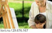 Old female painting a canvas. Стоковое видео, агентство Wavebreak Media / Фотобанк Лори