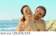 Купить «Handsome man massaging his wife», видеоролик № 29676519, снято 14 ноября 2010 г. (c) Wavebreak Media / Фотобанк Лори