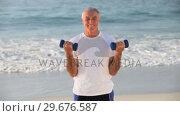 Купить «Elderly man working his muscles with dumbbells», видеоролик № 29676587, снято 14 ноября 2010 г. (c) Wavebreak Media / Фотобанк Лори