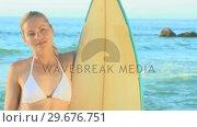 Купить «Beautiful blonde woman posing with her surfboard», видеоролик № 29676751, снято 15 ноября 2010 г. (c) Wavebreak Media / Фотобанк Лори