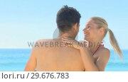 Купить «Blonde woman hugging her boyfriend on a beach», видеоролик № 29676783, снято 15 ноября 2010 г. (c) Wavebreak Media / Фотобанк Лори