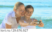Mother and daughter taking pictures. Стоковое видео, агентство Wavebreak Media / Фотобанк Лори