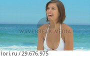 Купить «Gorgeous woman playing with a beach ball», видеоролик № 29676975, снято 15 ноября 2010 г. (c) Wavebreak Media / Фотобанк Лори