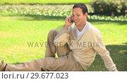 Купить «Young man phoning », видеоролик № 29677023, снято 16 ноября 2010 г. (c) Wavebreak Media / Фотобанк Лори