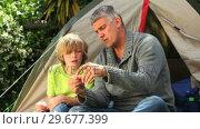 Купить «Father showing son how to prepare fishing tackle», видеоролик № 29677399, снято 6 ноября 2010 г. (c) Wavebreak Media / Фотобанк Лори