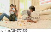Купить «Baby playing with parents on carpet», видеоролик № 29677435, снято 6 ноября 2010 г. (c) Wavebreak Media / Фотобанк Лори