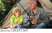 Купить «Man teaching fishing to his young son», видеоролик № 29677507, снято 6 ноября 2010 г. (c) Wavebreak Media / Фотобанк Лори