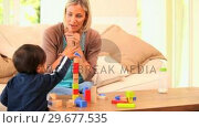 Купить «Baby learning to build a tower with blocks», видеоролик № 29677535, снято 6 ноября 2010 г. (c) Wavebreak Media / Фотобанк Лори