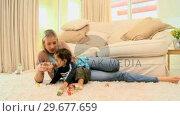 Купить «Toddler on carpet bored with building blocks», видеоролик № 29677659, снято 6 ноября 2010 г. (c) Wavebreak Media / Фотобанк Лори