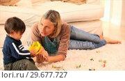 Купить «Mother playing with her little boy», видеоролик № 29677727, снято 6 ноября 2010 г. (c) Wavebreak Media / Фотобанк Лори