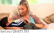 Купить «Blonde haired woman bottlefeeding her son», видеоролик № 29677751, снято 6 ноября 2010 г. (c) Wavebreak Media / Фотобанк Лори