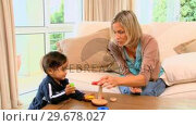 Купить «Mother with her little son playing», видеоролик № 29678027, снято 6 ноября 2010 г. (c) Wavebreak Media / Фотобанк Лори