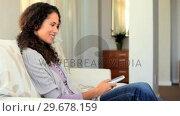 Купить «Young woman enjoying TV», видеоролик № 29678159, снято 5 ноября 2010 г. (c) Wavebreak Media / Фотобанк Лори