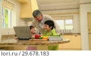 Купить «Children gathering ingredients for a recipe they have on a laptop», видеоролик № 29678183, снято 5 ноября 2010 г. (c) Wavebreak Media / Фотобанк Лори