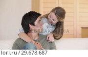 Купить «A couple watching TV», видеоролик № 29678687, снято 3 ноября 2011 г. (c) Wavebreak Media / Фотобанк Лори