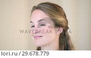 Купить «Blonde woman smiling at camera», видеоролик № 29678779, снято 3 ноября 2011 г. (c) Wavebreak Media / Фотобанк Лори