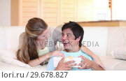 Купить «Wife giving a gift to her husband», видеоролик № 29678827, снято 3 ноября 2011 г. (c) Wavebreak Media / Фотобанк Лори