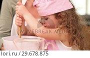 Купить «Girl preparing dough with her mother», видеоролик № 29678875, снято 3 ноября 2011 г. (c) Wavebreak Media / Фотобанк Лори