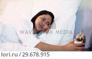 Купить «Woman happy to have time to sleep», видеоролик № 29678915, снято 3 ноября 2011 г. (c) Wavebreak Media / Фотобанк Лори