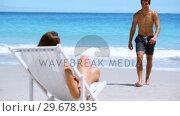 Купить «Young woman sunbathing», видеоролик № 29678935, снято 15 ноября 2011 г. (c) Wavebreak Media / Фотобанк Лори